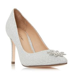 Beeming is a timeless court shoe set on a slim high heel. A classic slip on style featuring a pointed toe and jewelled brooch trim. The floral diamante embellished trim completes this feminine style.