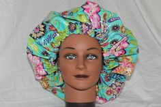 This reversible satin lined shower cap can be used to protect your hair in the shower as well as a heat cap when deep conditioning.