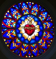 "Heart of Jesus Church, center window "" The Catholic Church values highly the institutions. Stained Glass Church, Stained Glass Art, Stained Glass Windows, Mosaic Glass, Catholic Art, Religious Art, Jesus E Maria, Rose Window, Church Windows"