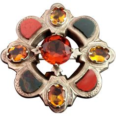 A gorgeous antique Victorian Scottish agate and Silver brooch.pCircular floral shape it is set to the centre with a large cairngorm quartz and has four rich yellow citrine.pThe brooch is further set with half moon shaped agates, including bloodstone, Montrose and red jasper.pThe brooch has an old c type clasp fastener.pThe reverse has a Victorian diamond registration mark but it is quite worn, tests as sterling silver, c1860s.pCondition:brGood used condition overall, a few tiny nicks to the ston Victorian Life, Moon Shapes, Agates, Red Jasper, Silver Brooch, Centre, Quartz, Type, Sterling Silver