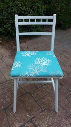 After picture of vintage desk chair - painted white with aqua coastal fabric.