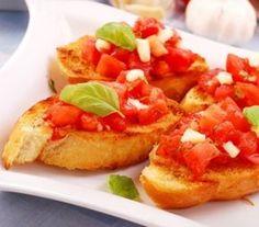 Grzanki z pomidorami i czosnkiem - Przepisy. Grzanki z pomidorami i czosnkiem to przepis, którego autorem jest: Magda Gessler
