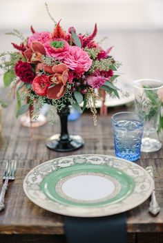 Chic colorful Southern wedding with vintage settings and glassware via Coastal Bride