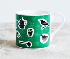 If you're passionate about your garden or know someone who is, then this is the perfect mug for you. The Gardening mug will transport you to happy and productive days pottering around outdoors in the fresh air. Its a beautiful green colour and has a charming and quirky design featuring favourite gardening tools such as a watering can, rake and plant pot along and little bird. This large bone china mug holds extra amounts of your favourite hot drink and is sure to become a firm favourite. £10