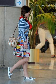 Her travel outfit is just the cutest, and I love how she rocks the Keds with her skirt!