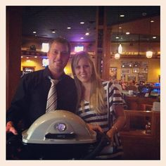 We love giving stuff away! Kale gives Chelsey her new BBQ for liking us on FB!