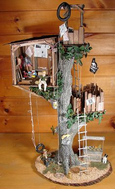 I'm definitely going to try and recreate this amazing tree house for my fairy garden