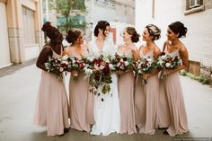 Beautiful bridesmaids and bouquets from Reid and Lea's wedding in Winnipeg, Manitoba | Photo by: Ariana Tennyson Photography
