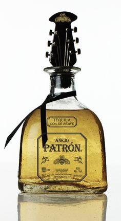 Food / Packaging of the World: Creative Package Design Archive and Gallery: Patrón Añejo Holiday 2012 Guitar Bottle Stopper