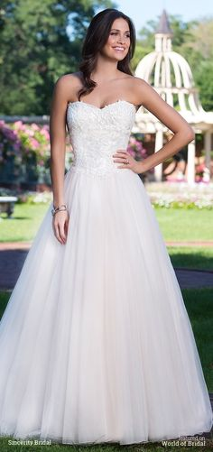 This sweetheart ball gown features a corset back, basque waistline, and tulle skirt that is perfect for the princess bride.