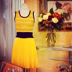 What a cute little yellow vintage dress hiding in the corner! Thanks Emblem Florist for the pretty flowers too!! #Padgram