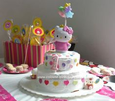 Homemade Hello Kitty Birthday Cake: I made this cake Hello Kitty Birthday Cake for my daugther's first birthday.   I made two cakes, a big one made with 8 eggs and a little one on top. I