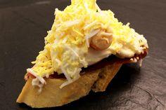 Huevo con langostino y jamón Ibérico