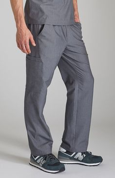 Tailored men's performance cargo scrub pant with seven deep pockets, four-way stretch and moisture-wicking fabric.