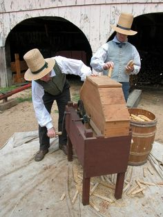 Working the corn shelling machine at the farm at Old Sturbridge Village during harvest time.