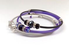 ONE Modern Skinny Rubber Bangle, Crystal beads, Memory Wire and Black, Violet, Grey or Blue tube.