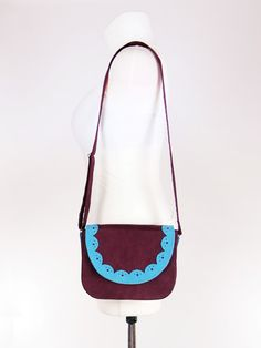 Purple bag with blue scalloped edge,