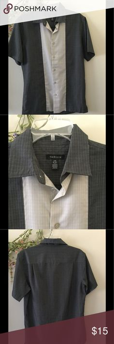 "Boys/Men's Van Heusen Dress Shirt Teen Boys Van Heusen Dress Shirt  Two tone Gray & Beige/Tan Clean shirt with no rips, stains or tears.  S/P 14-14 1/2""   My son wore the shirt once for a school event.  Stored in a closet.  Material:  57% Rayon and 43% Polyester  Machine wash and dry   Armpit to armpit 21"" inches Collar to bottom of shirt  30""  Under collar across shoulder 6""  Short sleeve 9 1/2"" inches  7 buttons down the front with the new button attached inside the front side of the…"