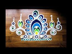 Here is a freehand rangoli designs with colours. I have used a funnel and a rangoli filler in this rangoli. Hope you like this rangoli design. Indian Rangoli Designs, Rangoli Border Designs, Colorful Rangoli Designs, Rangoli Ideas, Beautiful Rangoli Designs, Sanskar Bharti Rangoli Designs, Kolam Rangoli, Flower Rangoli, Free Hand Rangoli Design