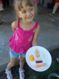 One of our little girls shows off the Armor of God Snack Man we made on Friday. The older kids all had to put together their own, and they put faces on them.