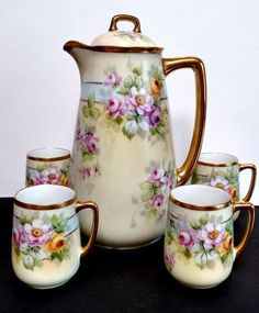 Howard Reury signed Antique Hand Painted Porcelain Bavaria Floral Coffee Tea Chocolate Pot w/4 cups - Gold handles and trim, 1900-1940. Early 20th Century China Porcelain. Could be used as a teapot or coffee pot.