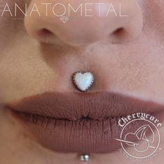 """cherrycorebodymod: """" This is a well healed philtrum piercing (that we didn't do) that we upgraded to wear this stunning heart shaped opal piece in white gold from Anatometal ^__^ so perfect! Monroe Piercings, Septum Piercings, Gauges, Medusa Piercing Jewelry, Mouth Piercings, Philtrum Piercing, Piercing Tattoo, Jewelry Tattoo, Body Jewelry"""