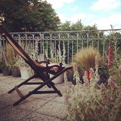 Relax on the roof terrace of RossoSegnale art gallery B&B Milan... The vintage cruise chair ...the sea seems so colse ...