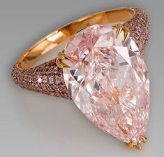 David Morris pear-shaped pink diamond ring set against a glimmering backdrop of pavé pink diamonds on a rose gold band. David Morris ring featuring a pear shaped Fancy pink diamond surrounded by a band of pink diamonds. Pink Diamond Ring, Beautiful Diamond Rings, Diamond Ring Settings, 4 Diamonds, Colored Diamonds, Pink Jewelry, Vintage Jewelry, Diamond Are A Girls Best Friend, Jewelry Collection