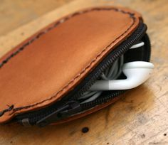 Keep your ear buds contained in this  Leather ear bud case by FatCatLeather, $22.00