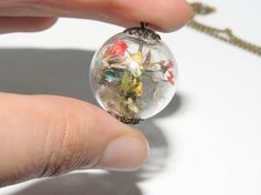 Pressed flower glass globe orb pendant, Yellow, blue and red pressed flowers necklace, Spring jewelry, Antique brass style. via Etsy. Antique Jewelry, Antique Brass, Real Flowers, Tiny Flowers, Baroque Pearl Necklace, Glass Globe, Brass Color, Jewelry Supplies, Jewelry Crafts