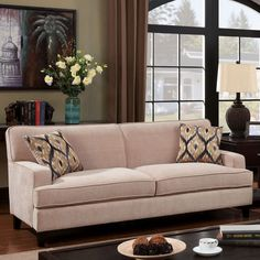 Padded for ultimate comfort, this Lawson style sofa offers warmth and style. Available in two chic colors, the Varinne Sofa features a solid hardwood frame, plush foam filling and a smooth flannelette exterior.