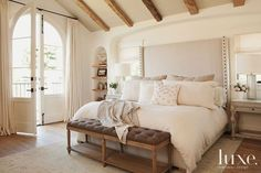 The dream bedroom... love the headboard, bench and side tables... and oh those doors!
