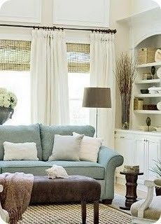 love the colors, textures and white drapes in this cozy family room.