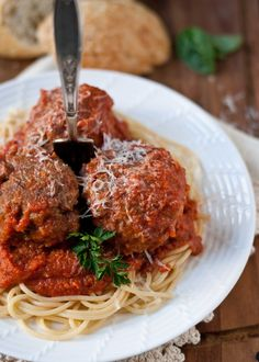 Classic Spaghetti and Meatballs by neighorhoodfoodblog: Giant, fluffy meatballs simmered in a homemade tomato basil sauce, this classic dish will make you feel like an Italian grandmother. #Pasta #Spaghetti #Meatballs