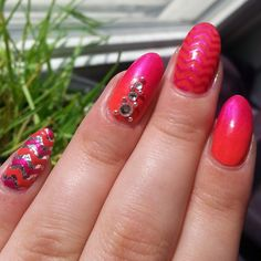 #mixandmatchnails  I'm loving these #swarovskicrystals from @daily_charme  the colors are @nyc_new_york_color #tangerinecreme and @revlon #wildstrawberry the glitter on the pinky is milani.