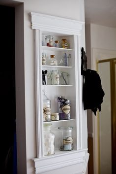 One of the amazing ways to do built-ins on a budget by Tidbits from the Tremaynes apothecary shelf featured on Remodelaholic.com