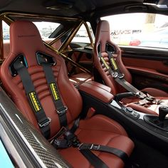 Interior of the beast. Custom OEM red fox leather on the M Performance seats and carbon fiber galore with a gold cage  #bmw #e92 #m3 #bmwrides #bmw_m_nation #bmwperformance