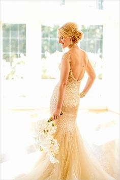 gold and sparkling wedding gown in wedding designed by Davia Lee Weddings http://www.weddingchicks.com/2014/02/22/davia-lee-weddings-and-events