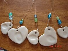 Fingerprint hearts... great for pendants, keychains, windchimes. I'd do these in ceramic clay and add a touch of color to one side of them... use the unglazed side to spritz with my favorite cologne. The heat from your body will continue to activate as you wear it next to your body!