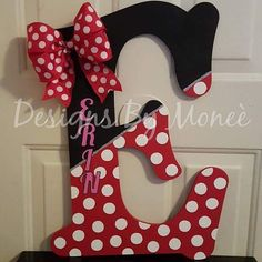 Minnie Mouse Theme Wooden Letter These Minnie Mouse themed letters are great for your little girl who loves the beloved Disney character. It consists of glitter, Minnie mouse's hairbow, and her dress design. The letter is 2 feet tall from longest points, Wooden Letter Crafts, Painting Wooden Letters, Diy Letters, Painted Letters, Wood Letters Decorated, Letters For Wall, Decorative Wooden Letters, Letter Wall, Letter Door Hangers