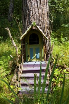 tiny-tree-house-door ~ This looks like a fun place for a child to play