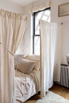 A Bed Enclosed by Curtains