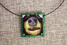"""Dachshund Hand-Illustrated Pendant – """"The Schnoz"""" - Can you hear the snoring? This close-up illustration of a sleeping Black & Tan Dachshund is precious! Hand-drawn with colored pencil on copper, then mounted on circuit board, this special process makes art to wear!"""