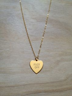 FUCK OFF Heart Necklace. $52.00, via Etsy.