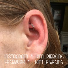 healed rook piercing with titanium segment ring done at skin-a-matic, Nijmegen
