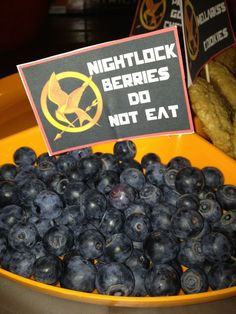 Nightlock Berries! Do Not Eat!!!! Hunger Games inspired party foods! Custom Food Sign Print Outs Available through Never Forgotten Designs for $5! http://www.etsy.com/listing/96352770/hunger-games-custom-food-labels-for-any