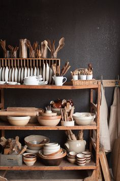 shelves stacked with simple, beautiful and usual bits and bobs