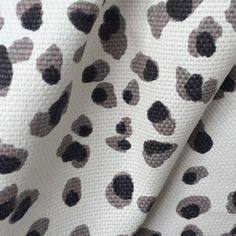 pillows - A black   grey leopard fabric that is sumptuous and weighty because everyone needs some animal print in their life!This fabric has a basket weave and is perfect for curtains,drapery, roman shades, upholstery, decorative pillows, seat cushions and many more home decor projects.Content:100%CottonWidth:54