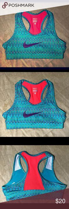 "EUC Nike Pro Teal and Orange Sports Bra - M Looks brand new. Size medium. Teal and bright orange with purple Nike logo. Length: 10"" Bust: 13"". Band: 11.5"" Nike Intimates & Sleepwear Bras"