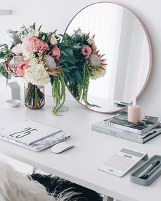 Simple decorative accents provided by the use of a small bouquet of flowers against light backfrop